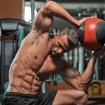 Homem na academia treinando abdomen